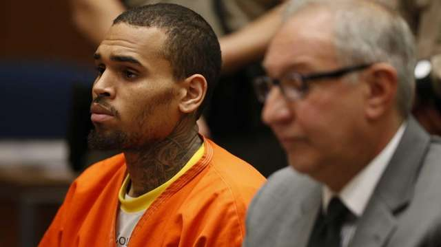 R&B singer Chris Brown, left, appears in Los