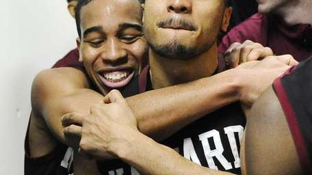 Harvard's Siyani Chambers, left, and Brandyn Curry, right,