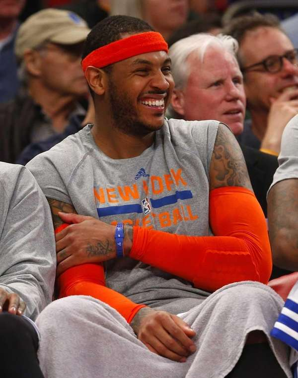 Carmelo Anthony has a laugh on the bench