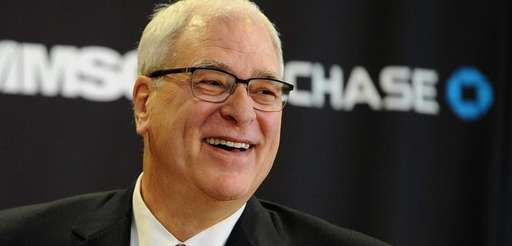 Phil Jackson answers questions during the news conference