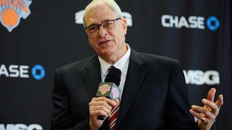 Phil Jackson answers questions during the press conference