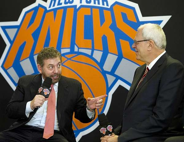 Knicks owner James Dolan, left, talks to the