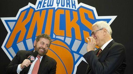 Knicks owner James Dolan, left, talks to the