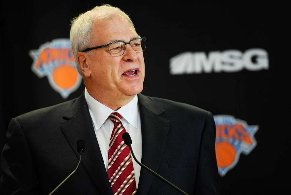 Phil Jackson addresses the media during his introductory