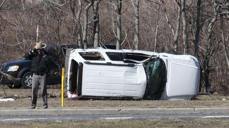 New York State Police investigate a vehicle that
