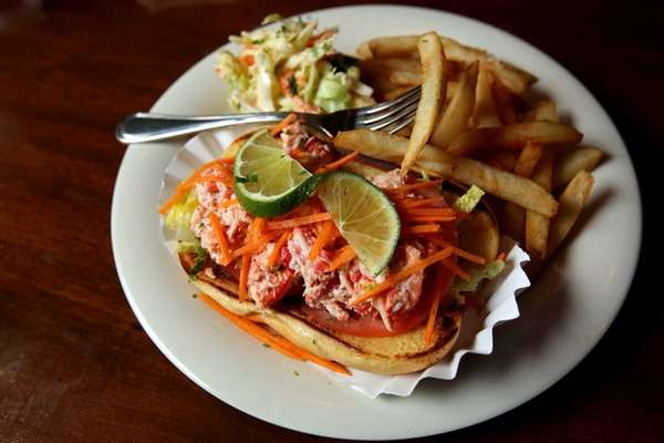 The lobster roll topped with shredded carrots is