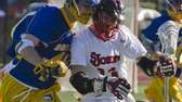 Hofstra's Finn Sullivan, left, collides with St. John's
