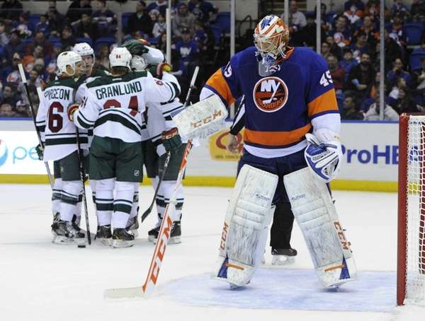 Islanders goalie Anders Nilsson stands in goal as