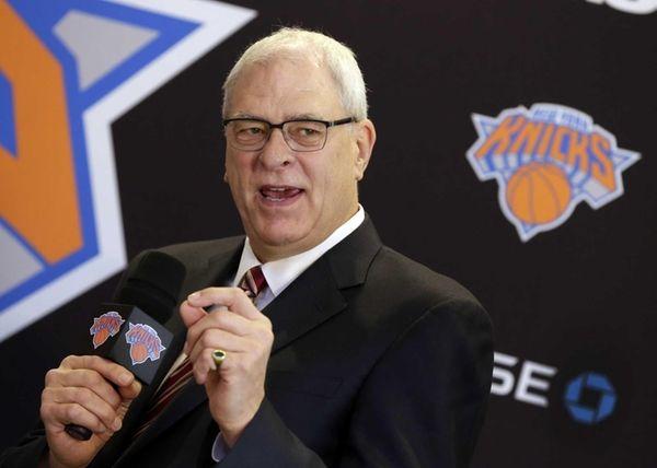 Knicks team president Phil Jackson responds to a