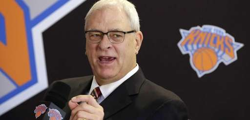 Knicks team president Phil Jackson responds to a