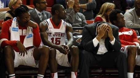 The St John's bench reacts as time expires