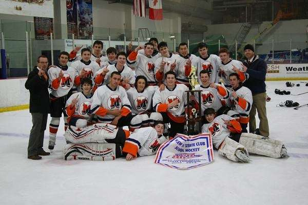 The Manhasset boys hockey team poses after winning