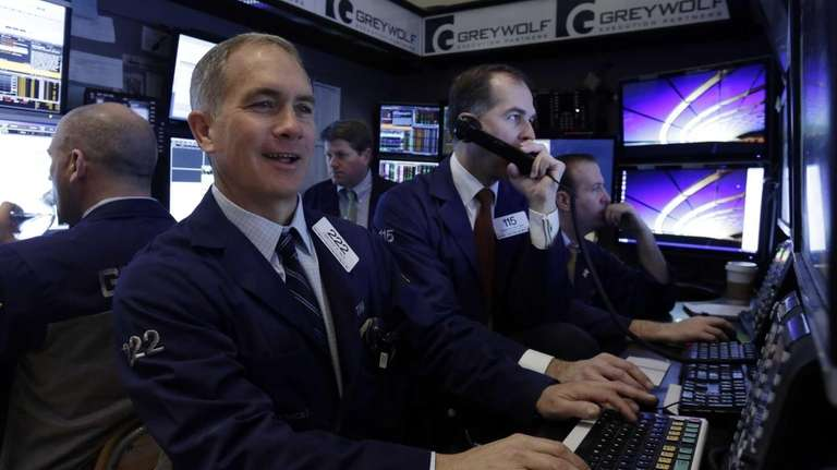 Trader Timothy Nick works with colleagues in a