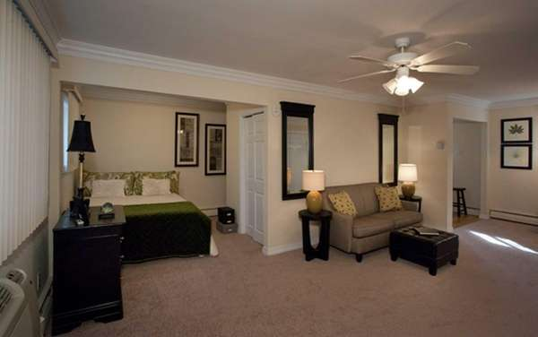 This Sayville studio apartment has carpeting, crown and
