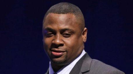 Former NFL player Troy Vincent speaks at a