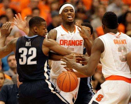 Syracuse's C.J. Fair, center, and Jerami Grant, right,