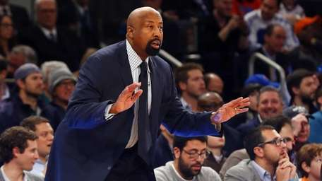Mike Woodson of the Knicks reacts in the