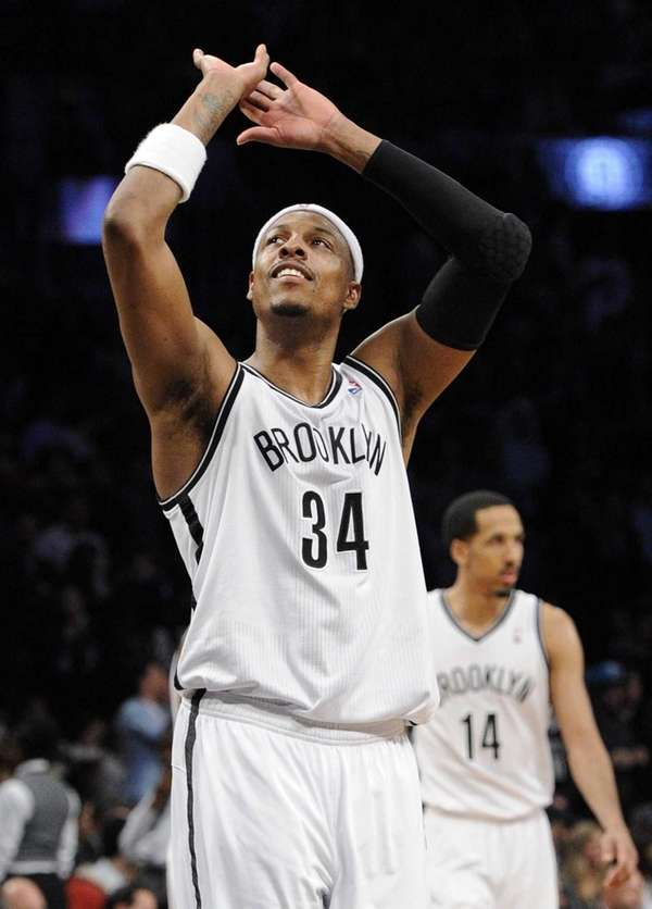 Nets forward Paul Pierce reacts on the court