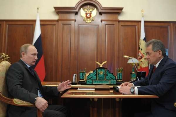 Russian President Vladimir Putin speaks with Defense Minister