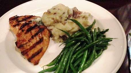 Wood-grilled salmon with garlic mashed potatoes and green