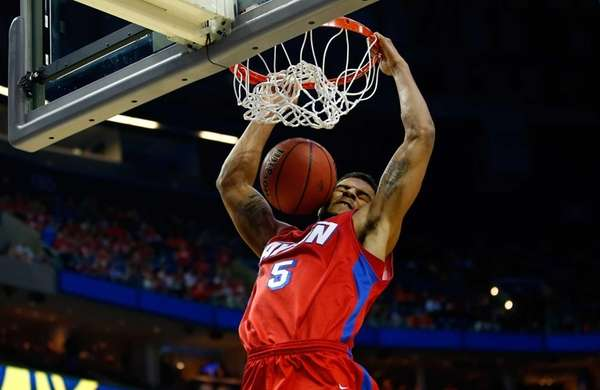 Dayton's Devin Oliver dunks the ball during a