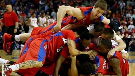 The Dayton Flyers celebrate after defeating the Ohio