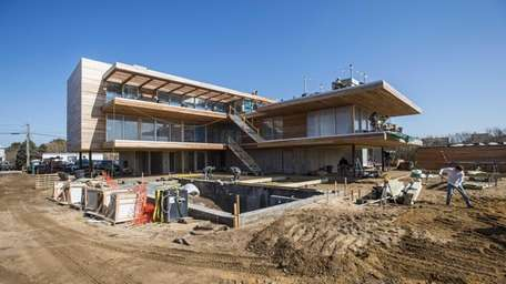 An oceanfront home being built by Fred G.