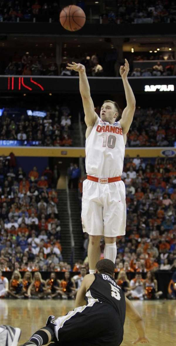 Syracuse's Trevor Cooney shoots over Western Michigan's David