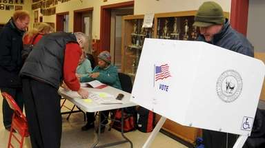 Voters cast their ballots in the special village