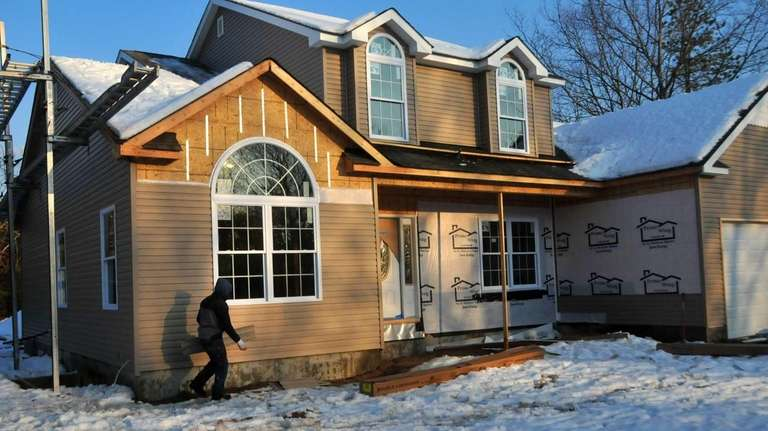 Construction proceeds on a home in Yaphank last