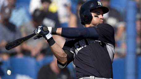 Yankees' Jacoby Ellsbury strikes out during the sixth