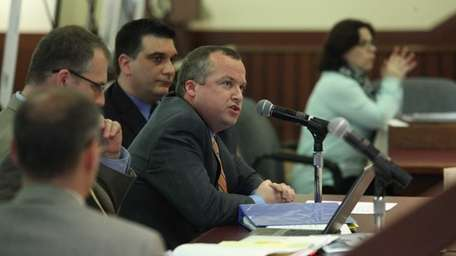 Deputy County Executive Rob Walker offers testimony regarding