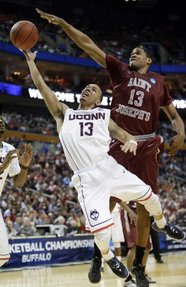 Connecticut's Shabazz Napier drives past Saint Joseph's Ronald