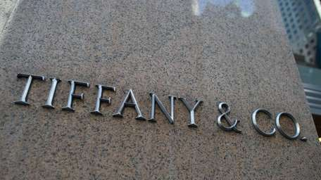 Tiffany and Co. signage is displayed outside the