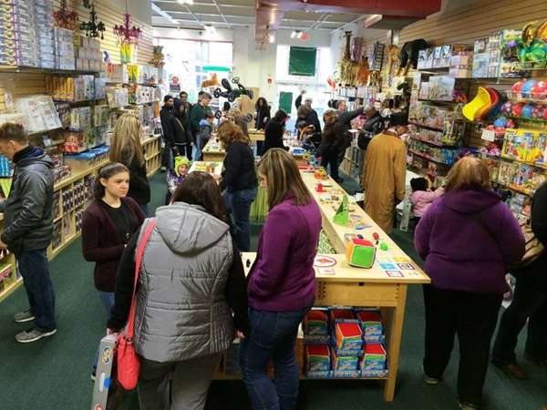 Holiday shoppers at Lainie's Way toy store in