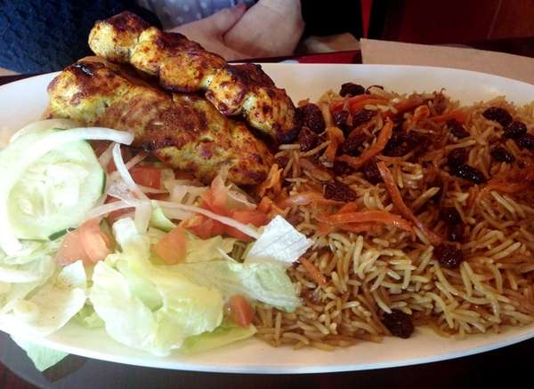 Kababs come with brown rice strewn with carrots