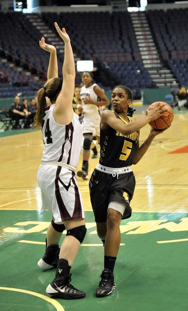 St. Anthony's Sarah Edmond is defended by Ossining's