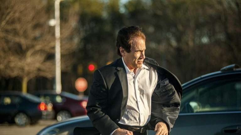 Paul Hyman leaves District Court in Central Islip