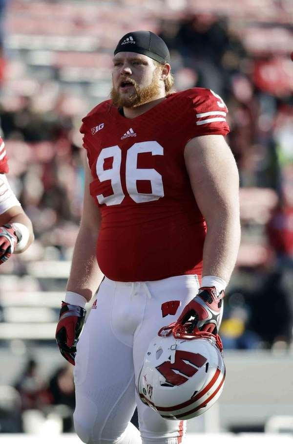Wisconsin's Beau Allen warms up before an NCAA