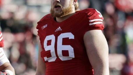 Wisconsin's Beau Allen warms up before an NCAA