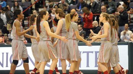 Long Island Lutheran players celebrtae a 53-42 win
