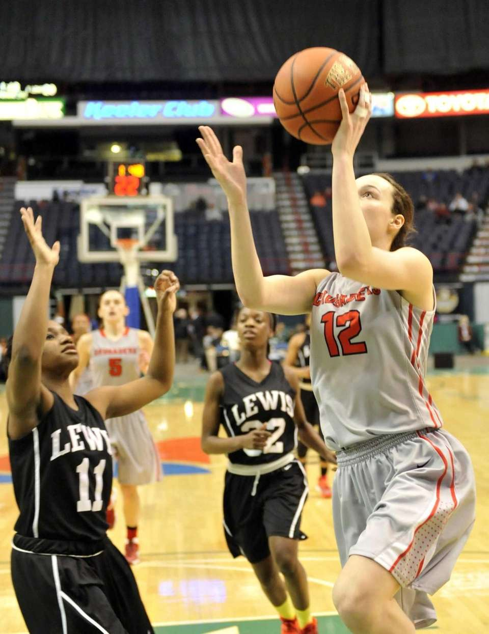 Long Island Lutheran's Katie Lavelle is defended by