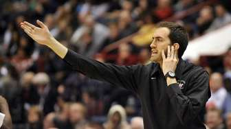 Long Island Lutheran head coach John Buck directs