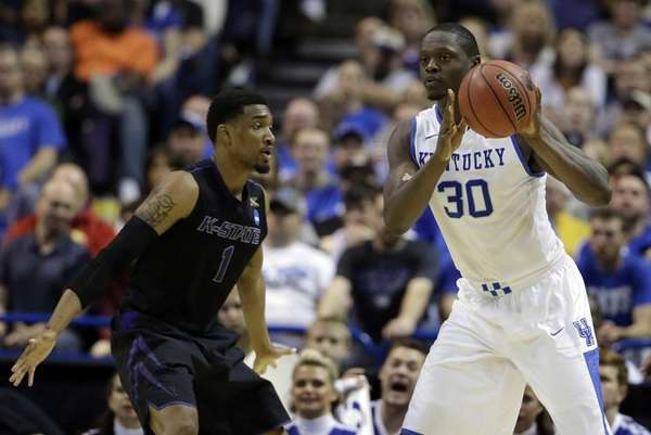 Kentucky's Julius Randle, right, passes as Kansas State's