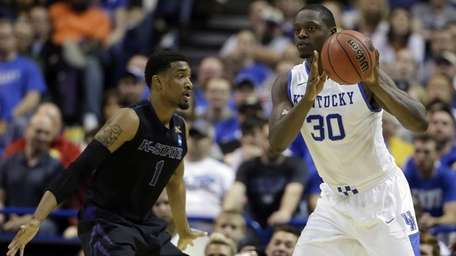 Kentucky's Julius Randle, right, passes as Kansas State's
