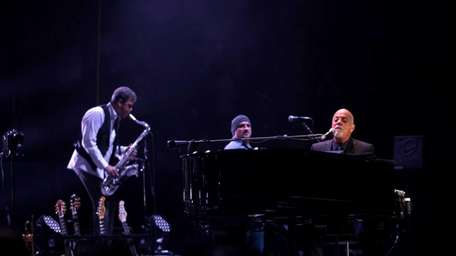 Billy Joel performs on stage at Madison Square