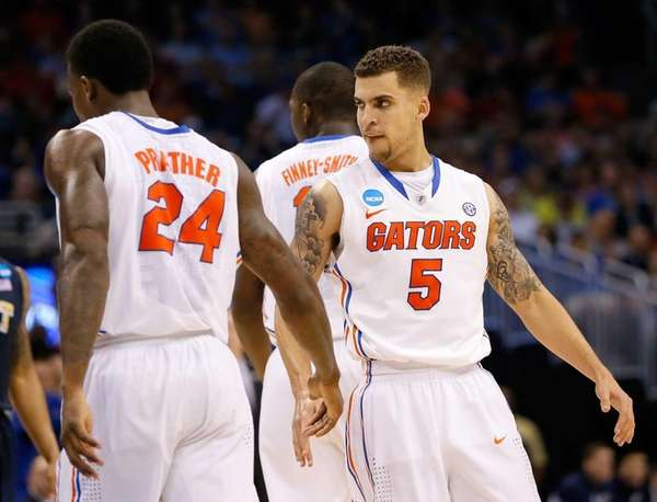 Scottie Wilbekin #5 of the Florida Gators reacts