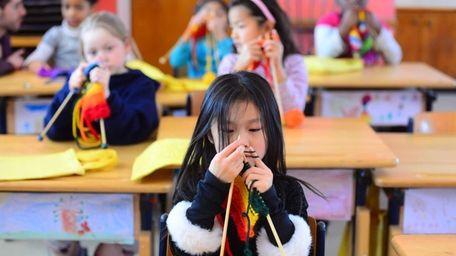 Coleen Li, 5, participates in a knitting class