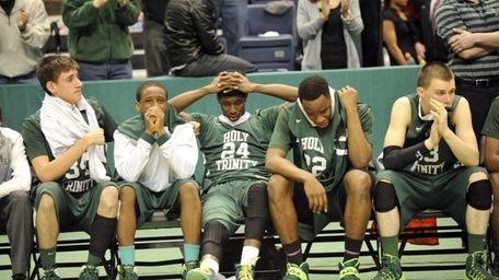 Holy Trinity players react to a 68-52 loss