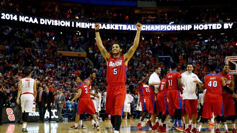 Devin Oliver of the Dayton Flyers reacts after